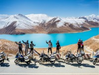 Riders pose in Yamdrok Lake